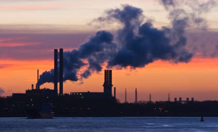 shiprepair: Silhouette of industry and industrial pollution at sunset in winter  Stock Photo