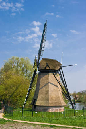 Dutch mill in city with residential houses in background Stock Photo - 4712423