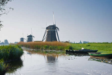 Three watermills in a row build to pump water out of the polder Stock Photo - 4810818