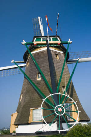 watermills: Dutch watermill backside with wheel to turn wings in the wind Stock Photo