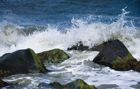 Rocks with breakers at the coast on sunny day Stock Photo - 4862718