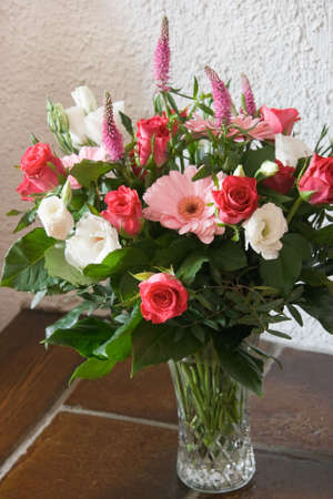 Glass vase with roses and gerberas in red, white and pink Stock Photo - 4862779