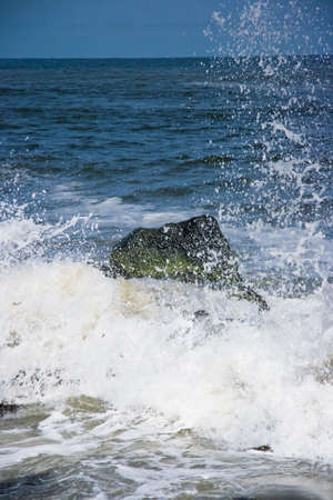 Breakers on rocks at the coast on sunny day with lots of foam Stock Photo - 4862777