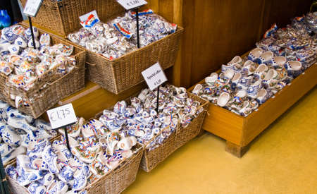 delftware: Display of Dutch blue delftware clogs in baskets offered for sale as a souvenir