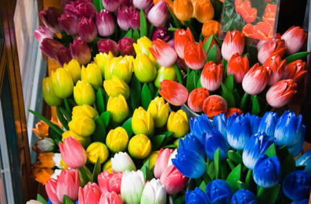 Colorful wooden tulips offered in shop for sale as a souvenir  photo