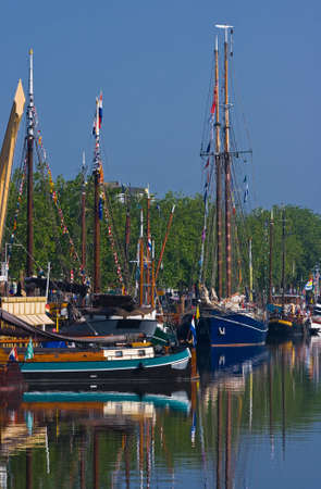 fishingboats: Ships in harbour decorated with flags-yearly festival in summer