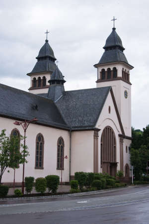 archtecture: Church in the rain in city Wasserbillig, Luxembourg, Europe
