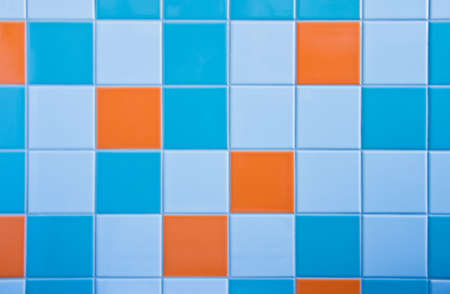 Part of wall in bathroom with tiles in light blue, azure blue and orange Stock Photo - 5650738