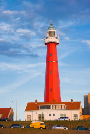 Red lighthouse in evening light with blue sky background Stock Photo - 5865017