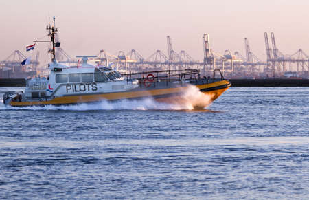 pilot light: Pilot-boat passing by at high speed on the river in evening light - industry background Stock Photo