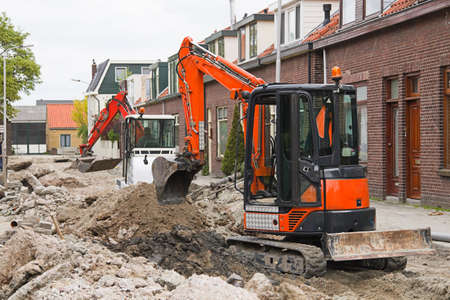bulldoze: Breaking up the street to renew the sewerage - horizontal image