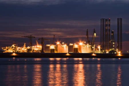 shiprepair: Construction- and ship-repair industry by night with reflection of the lights in the river