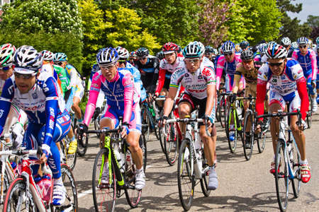 DELFGAUW, NETHERLANDS - MAY 10: Competitors and following teams in the Giro d�Italia passing by on a polderroad in the 3th stage of the competition on May 20, 2010, Delfgauw, the Netherlands.