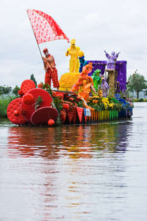 WESTLAND,THE NETHERLANDS - AUGUST 2009: Fabulous decorated boats in the spectacular annual Westland Floating Flower Parade August 02, 2010, Maasland, the Netherlands.