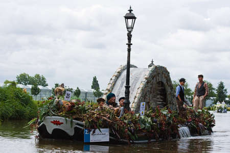 westland: WESTLAND,THE NETHERLANDS - AUGUST 2009: Fabulous decorated boats in the spectacular annual Westland Floating Flower Parade August 02, 2010, Maasland, the Netherlands.    Editorial