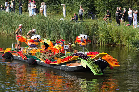 flower parade: VLAARDINGEN, THE NETHERLANDS - JULI 2010: Beautiful flower boats in the unique annual Westland Floating Parade Juli 30, 2010, Vlaardingen, the Netherlands.