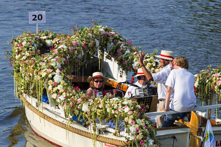 VLAARDINGEN, THE NETHERLANDS - JULI 2010: Beautiful flower boats in the unique annual Westland Floating Parade Juli 30, 2010, Vlaardingen, the Netherlands.