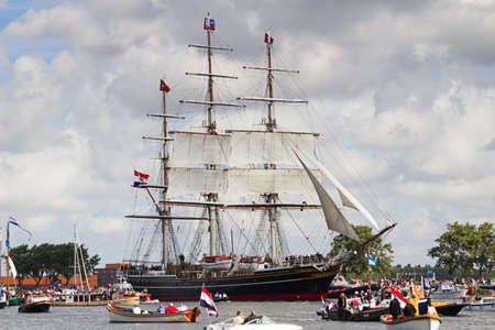 canal parade: SAIL AMSTERDAM 2010 -IJMUIDEN, THE NETHERLANDS - AUGUST 2010: Sail 2010 starts with the spectaculair Sail-in Parade.  50 Tall ships and more than 500 of  naval ships, replicas and yachts sail in convoy through the North Sea Canal from IJmuiden to Amsterda Editorial