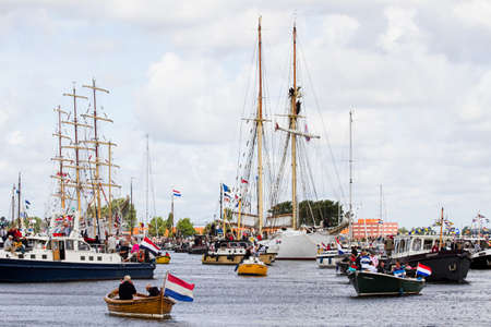 SAIL AMSTERDAM 2010 -IJMUIDEN, THE NETHERLANDS - AUGUST 2010: Sail 2010 starts with the spectaculair Sail-in Parade.  50 Tall ships and more than 500 of  naval ships, replicas and yachts sail in convoy through the North Sea Canal from IJmuiden to Amsterda Stock Photo - 7659635