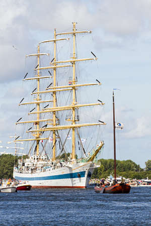 convoy: SAIL AMSTERDAM 2010 -IJMUIDEN, THE NETHERLANDS - AUGUST 2010: Sail 2010 starts with the spectaculair Sail-in Parade.  50 Tall ships and more than 500 of  naval ships, replicas and yachts sail in convoy through the North Sea Canal from IJmuiden to Amsterda Editorial