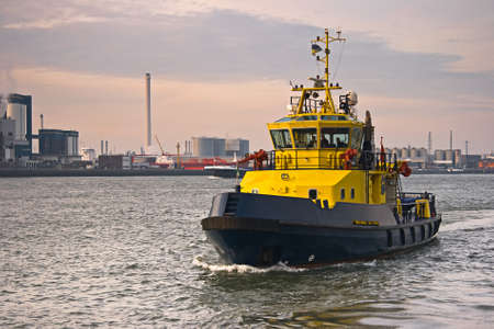work boat: Tug on the river with industrial background