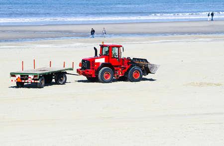 bulldoze: Work at the beach - preparing for summerseason - transportation