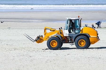 bulldoze: Work at the beach - preparing for summerseason - lifting and transportation