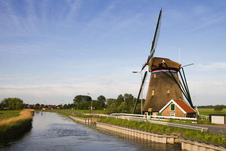Dutch windmill and country road on beautiful morning Stock Photo - 9552338