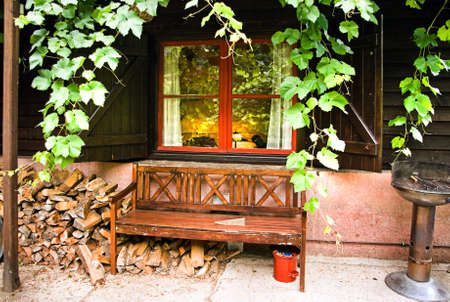 countrylife: Grape twines are growing around small cottage with garden-bench on early summermorning