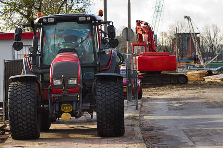 bulldoze: Streetwork in the city with tractor, draglines and caterpillar  Stock Photo