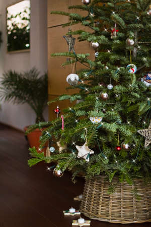 Christmas tree withs lights and decoration - vertical and shallow dept of field photo