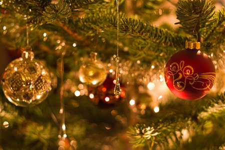 Decoration in christmas tree with balls and lights red and silver - shallow dof