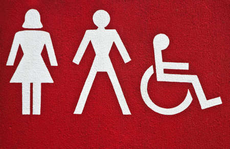 privy: Symbols female, male and physically disabled on building with sanitary rooms Stock Photo