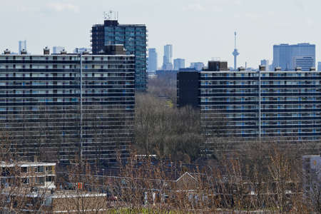 View over suburb Vlaardingen, the Netherlands, with appartment buildings and skyline Rotterdam with Euromast in background