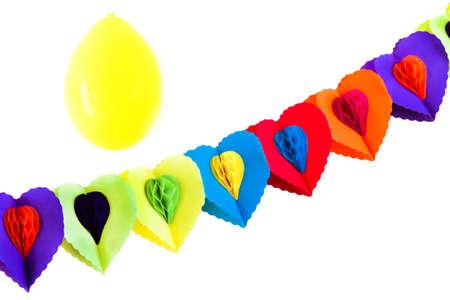 festoon: Party decoration - festoon and yellow balloon on white background Stock Photo