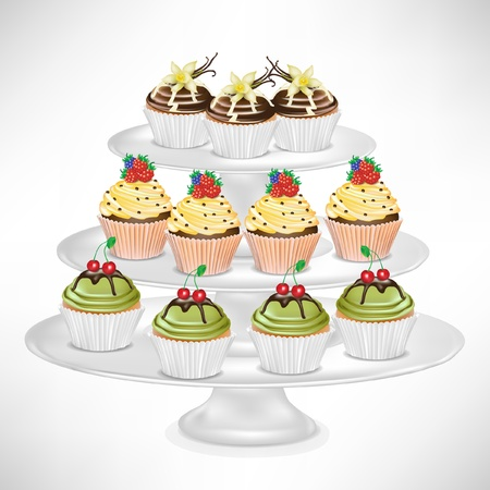 decorated cake: cup cake on dessert stand isolated on white