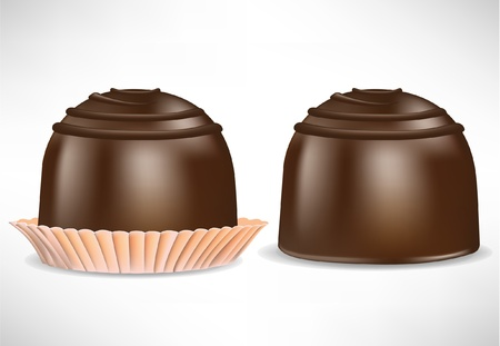 praline: two pieces of chocolate candy isolated on white
