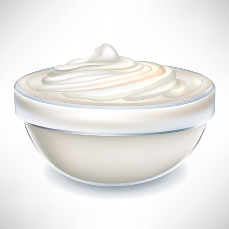 whipped cream: yogurt cream in transparent bowl isolated on white