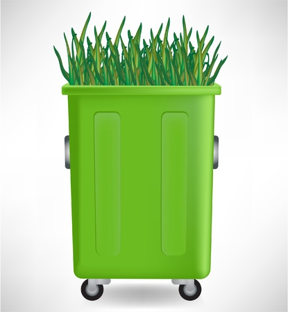 dustpan: plastic green trash container with growing grass isolated