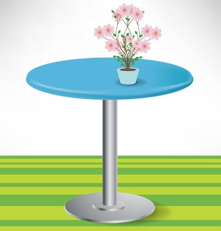 metal legs: simple round unoccupied table with flower decoration isolated