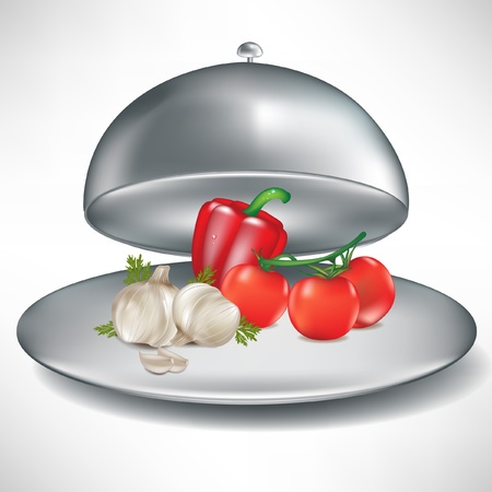 domed tray: open catering tray with tomatoes, garlic and pepper isolated