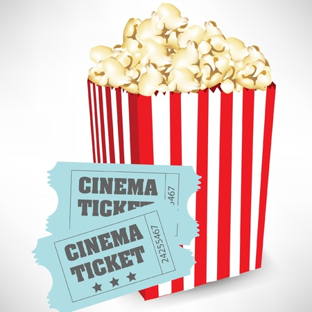 movie popcorn: popcorn container and cinema tickets isolated on white