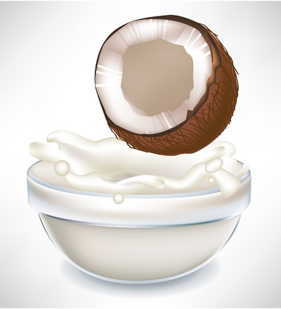 energy drink: coconut and creamy milk splash in transparent bowl isolated on white