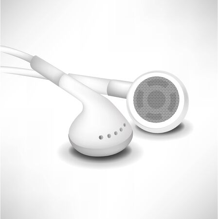 earphones: two white headphones in close up