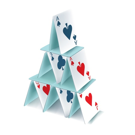 built: playing cards pyramid isolated on white