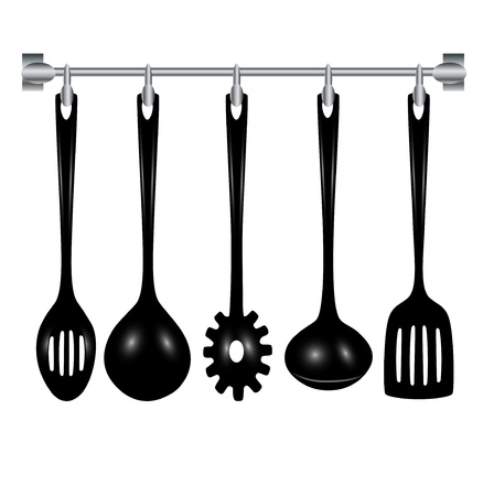 implements: kitchen utensils hanging isolated on white