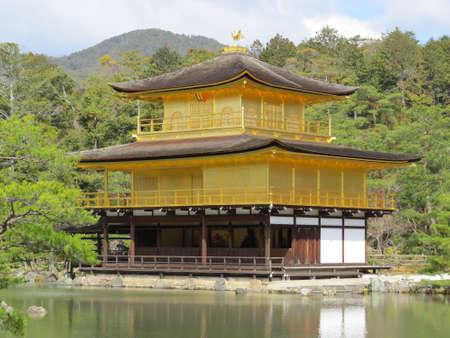 pavillion: Golden pavillion in an ornamental garden