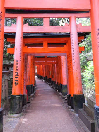 straddle: Hundreds of orange gates straddle the pathway which leads to the Fushimi Inari Shrine. Each gate has been donated by an individual in memory of a loved one.