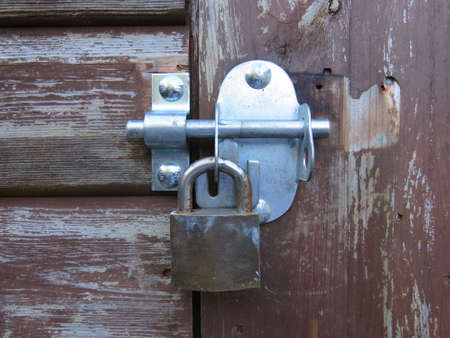 deterent: Padlock securing the door of a shed Stock Photo