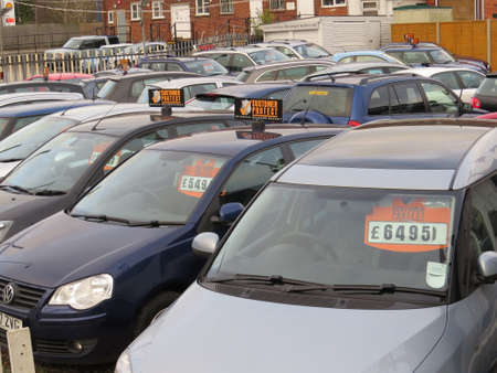Used cars for sale on a garage forecourt
